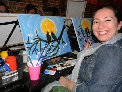 Smiling participant paints at Paint & Sip Studio LA event. (PRNewsFoto/Paint & Sip Studio LA) (PRNewsFoto/PAINT & SIP STUDIO LA)