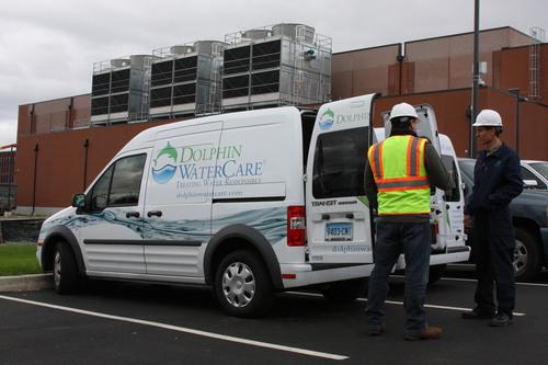 Dolphin WaterCare service technicians prepare to provide water treatment service at a customer site. The ...