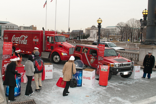 At Union Station today, morning commuters made donations to Toys for Tots before the official close of the holiday gift drive on Tuesday, December 21, 2010. U.S. marines in uniform greeted commuters alongside the U.S. Marine Corps red Hummer and Coca-Cola hybrid truck. The Coca-Cola Company joined forces with the U.S. Marine Corps Reserve Toys for Tots to encourage D.C. area residents to make toy donations.  (PRNewsFoto/The Coca-Cola Company, Gustavo Gargallo)