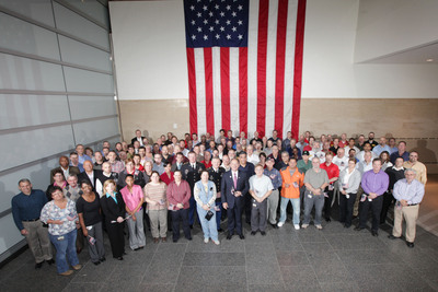 Union Pacific military veteran employees surround CEO Jack Koraleski (center, wearing tie) during a special Veterans Day celebration at the company's headquarters in Omaha, Neb. The event included Union Pacific making a $60,000 donation to Wounded Warrior Project. Union Pacific hired nearly 800 veterans so far in 2012.  (PRNewsFoto/Union Pacific)