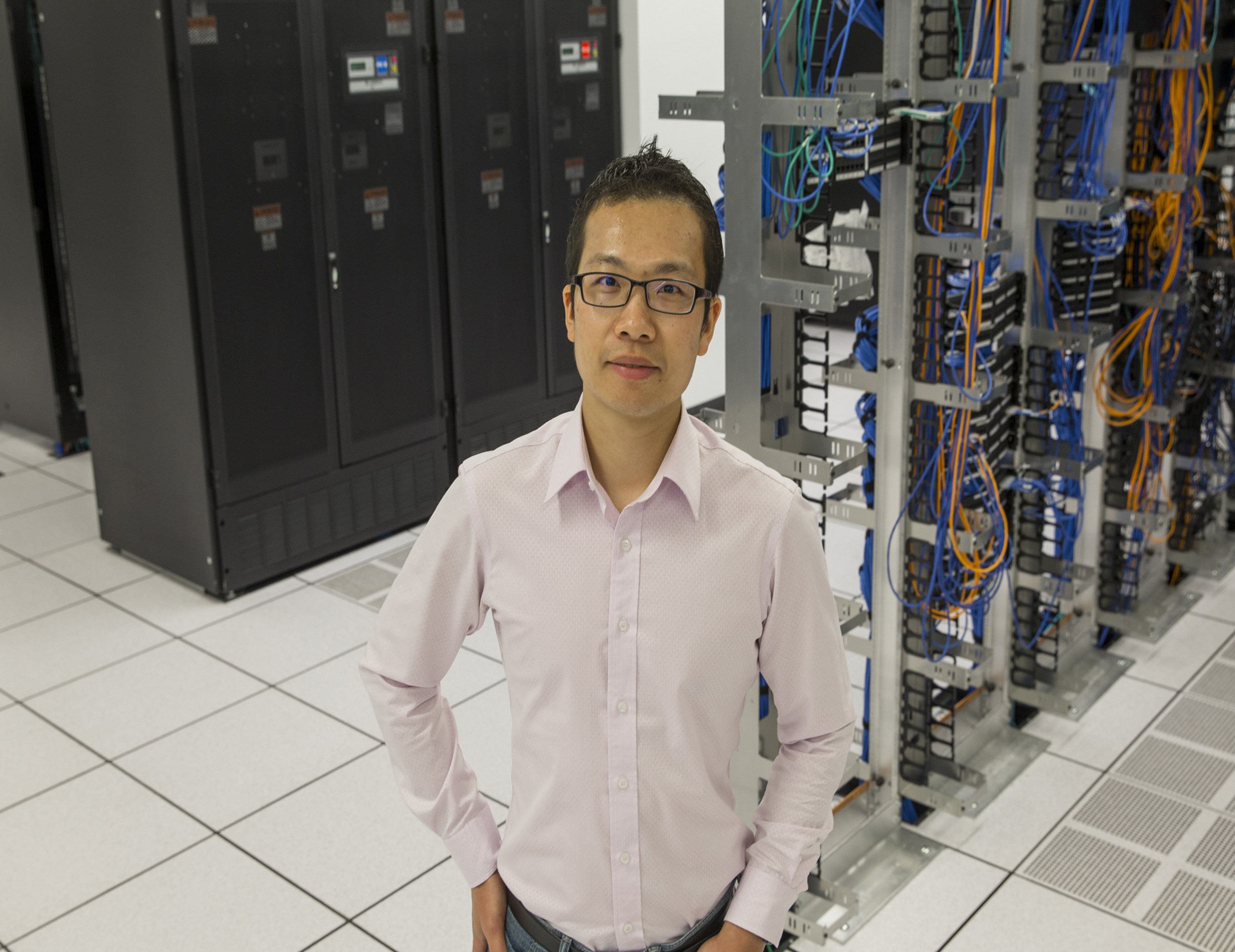 Yizhao Ni, PhD, a researcher in the Division of Biomedical Informatics at Cincinnati Children's Hospital Medical Center, stands in the institution's research data warehouse. Ni and his colleagues are mining electronic health record data and blending human and artificial intelligence to find better ways to recruit patients for clinical trials. They report research results on April 27 in the Journal of the American Medical Informatics Association.