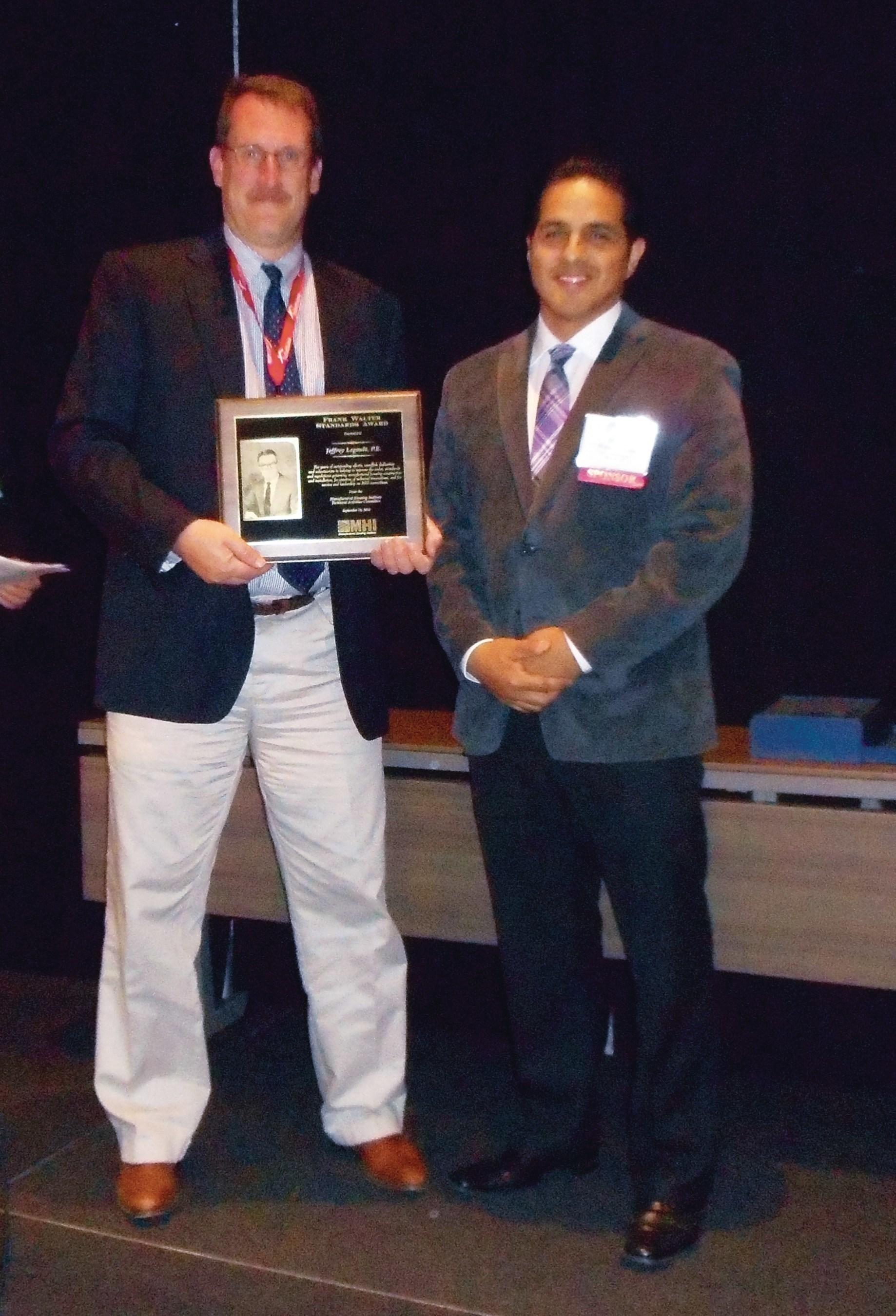Jeffrey Legault (left) of Skyline Corporation receives the 2016 Frank Walter Standards Award from MHI.