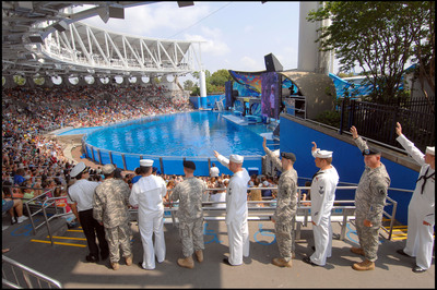In addition to the current Waves of Honor(TM) military salute program offering complimentary admission to members of America's armed forces, SeaWorld Parks & Entertainment(TM) is honoring all the men and women who have previously served as members of the U.S. armed services. Qualified service members and veterans include active duty, retired, honorably separated officers and enlisted personnel of the U.S. military. The special offer provides 50 percent off single day admission to the SeaWorld(R) and Busch Gardens(R) Parks, and Sesame Place(R) for veterans and service members, and as many as five guests. Tickets must be purchased by November 11, 2013.  (PRNewsFoto/SeaWorld Parks & Entertainment)