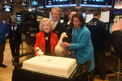 Aflac Chairman and CEO Dan Amos and Aflac Foundation President Kathelen Amos look on as Jean Amos, the wife of Aflac co-founder Paul S. Amos, cuts the cake at the company's 60th anniversary celebration at the NY Stock Exchange.