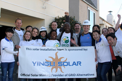 Yingli employees install solar with GRID for a low-income family in CA.  (PRNewsFoto/Yingli Green Energy Holding Company Limited)