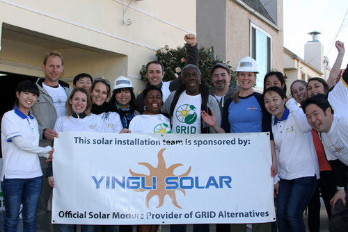 Yingli employees install solar with GRID for a low-income family in CA.  (PRNewsFoto/Yingli Green Energy ...