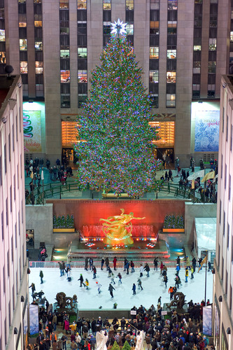 The Rink at Rockefeller Center with skaters under the iconic Christmas Tree.  (PRNewsFoto/The Rink at ...