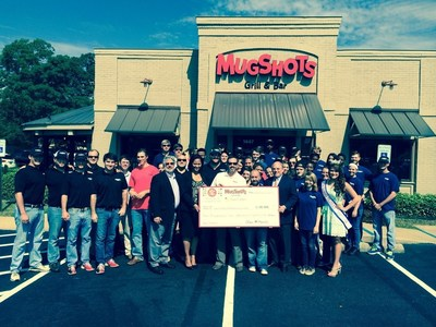 Mugshots Grill & Bar donates $10,185 to Twin Cedars Child Advocacy Center. Mugshots held a soft opening fundraiser this past weekend to celebrate the opening of location number twelve in Auburn, AL. With today's donation, the Mugshots brand has donated over $40,000 to child advocacy centers across the local Mugshots communities. (PRNewsFoto/Mugshots Grill & Bar)
