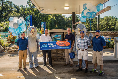 Peachtree City, Georgia, car wash, Tidal Wave Auto Spa, sold DRB Systems' 4 millionth FastPass(R) RFID tag. Pictured in front of the Xpress Pay Terminal(R) by DRB Systems(R): Tidal Wave Staff, Dennis Martin, Jon Richardson and Destin Marsh, Tidal Wave mascot, Tidal Wave owner, Scott Blackstock, and Tidal Wave customer Gene Goins.