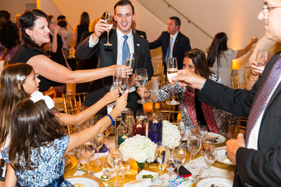 Gala Attendees Participate in the Traditional Champagne (and water) Toast