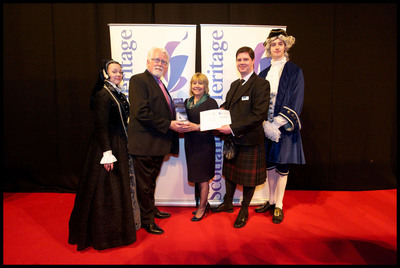 "Dennis Savage, Senior Vice President of CIE Tours accepts the Scotland's Heritage ""Travel Operator of the Year"" award from Linda Melils of Discovering Distilleries and Graeme Bowie of Historic Scotland.  (PRNewsFoto/CIE Tours International)"