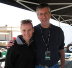 "Harry Mallin at the Infineon Raceway for the TTXGP zero emissions race being congratulated on his well deserved win by Chelsea Sexton, (the star of ""Who Killed the Electric Car?""). (PRNewsFoto/Brammo Inc)"