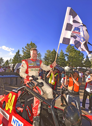 Greg Tracy and his Mitsubishi MiEV Evolution III emerged victorious in the Electric Vehicle division of the 2014 Pikes Peak International Hill Climb. (PRNewsFoto/Mitsubishi Motors North America)