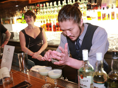 "Takeshi Uzuka, winner of New York USBG Legacy Cocktail Showcase sponsored by BACARDI pouring his winning cocktail, ""Room No.202"". (PRNewsFoto/BACARDI) (PRNewsFoto/BACARDI)"