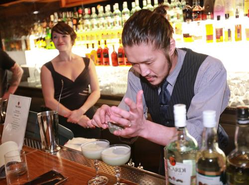 "Takeshi Uzuka, winner of New York USBG Legacy Cocktail Showcase sponsored by BACARDI pouring his winning cocktail, ""Room No.202"".  (PRNewsFoto/BACARDI)"