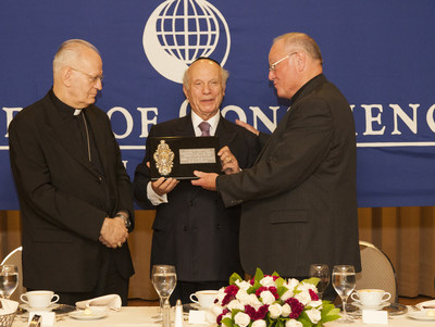"Presentation: (L to R) Cardinal Peter Erdo, Rabbi Arthur Schneier and Cardinal Timothy M. Dolan ""Cardinal Peter Erdo, Primate of Hungary, President of the Council of the Bishops' Conference of Europe and Trustee of the Appeal of Conscience Foundation is presented the ""Citation of Appreciation"" by Cardinal Timothy M. Dolan and Rabbi Arthur Schneier."""