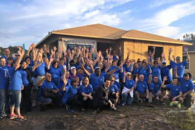 National Association of Realtors(R) President Tom Salomone joins more than 100 Realtors(R) at a Habitat for Humanity volunteer build day to kick off the 2016 REALTORS(R) Conference & Expo.