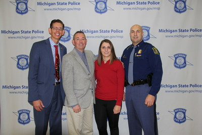 (Pictured left to right) Dr. David G. Hornak, Superintendent of Schools, Holt School District; Jeffrey Nelson, Vice President of Communications, Verizon; Alaina McFarland, senior, Holt High School and Captain Chris Kelenske, Deputy State Director of Emergency Management and Homeland Security, Michigan State Police, gather at Holt High School in Holt, Michigan for the Michigan State Police and Verizon campaign to warn teenagers about the dangers of distracted driving.