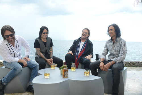 The members of Mana enjoying a glass of Chivas Regal.  (PRNewsFoto/Pernod Ricard USA)