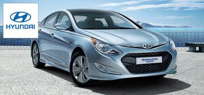 Drivers make their rides more efficient in the 2014 Hyundai Sonata Hybrid. (PRNewsFoto/Hesser Hyundai)