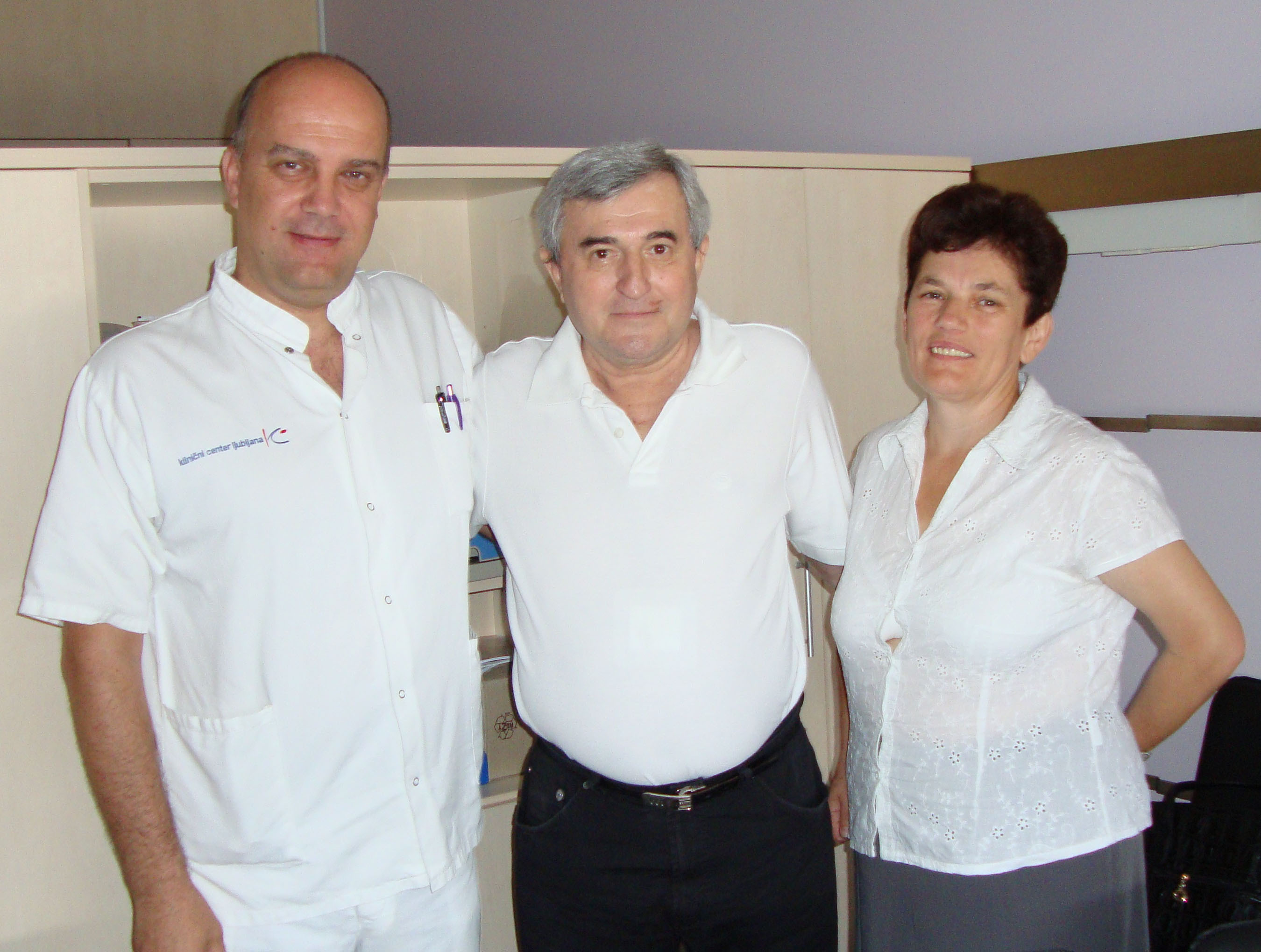 Slovenia's first SynCardia Total Artificial Heart patient Nikola Gaspic (middle) was bridged to a heart transplant on July 1, 2012. He is pictured post-transplant with his surgeon Dr. Ivan Knezevic and his wife Danica at University Medical Center (UMC) Ljubljana.  (PRNewsFoto/SynCardia Systems, Inc.)