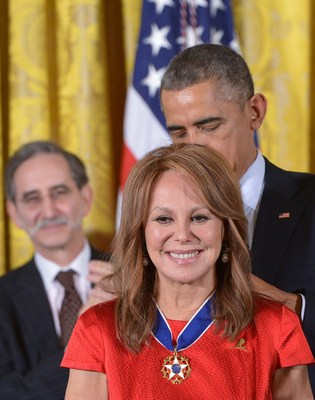 US President Barack Obama presents the Medal of Freedom to actress and St. Jude National Outreach Director Marlo Thomas during a ceremony in the East Room of the White House on November 24, 2014 in Washington, DC. The Medal of Freedom is the country's highest civilian honor. Photo Credit: AFP PHOTO/Mandel NGAN