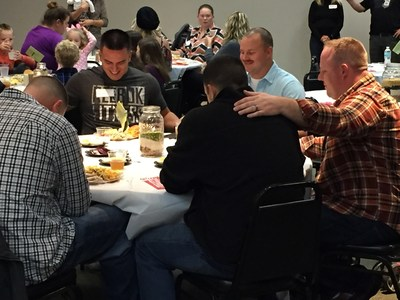 Warriors bless the food during the 2016 Thanksgiving dinner event hosted by Christ's Church and Wounded Warrior Project, in Jacksonville, FL.