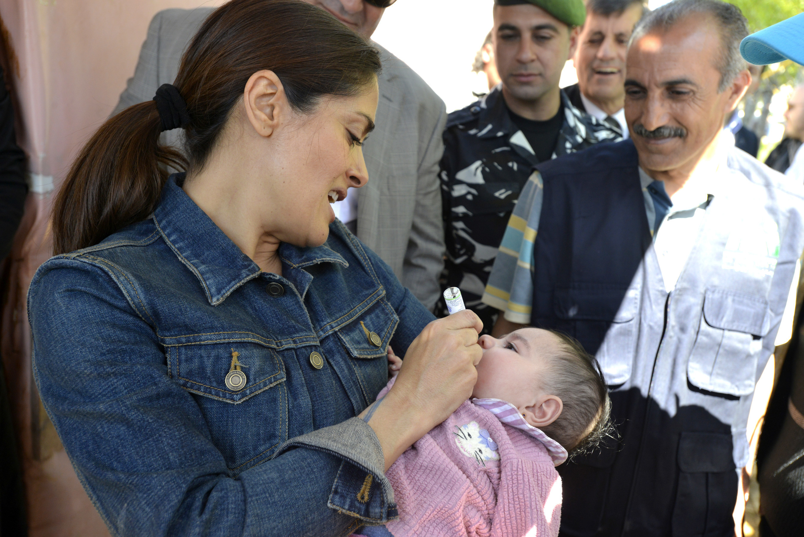 Salma Hayek administers an oral polio vaccine to a Syrian refugee child in Lebanon's Bekaa Valley with UNICEF. As part of her visit to the region, Hayek witnessed a UNICEF-supported polio immunization campaign targeting high risk areas to protect nearly 190,000 children under the age of five from the crippling disease. Hayek also helped launch Gucci's CHIME for the Children of Syria, a fundraising appeal to support children and families affected by the crisis in Syria.