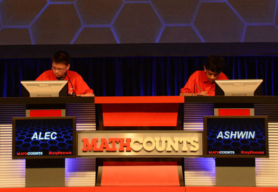Alec Sun, an 8th-grader from Lexington, Mass., competes against Ashwin Sah, an 8th-grader from Portland, Ore., in the final Countdown Round of the 2013 Raytheon MATHCOUNTS National Competition in Washington, D.C. Sun went on to win the National Champion title.  (PRNewsFoto/Raytheon Company)