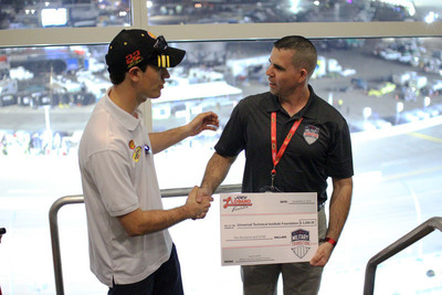 With the help of NASCAR driver Joey Logano and his No. 22 car sponsor Shell Oil Company, the Universal Technical Institute (UTI) Foundation launched its Military Transition Support (MTS) program Friday, November 8, by surprising a disabled military veteran, Starrbuck Long, and his family with $5,000 and a $500 Shell V-Power gift card at Phoenix International Raceway. MTS will ensure that U.S. military veterans and their families have the resources available to achieve their career ambition of receiving a technical education by providing grants to cover day-to-day expenses related to school to ease their transition back into civilian life.  (PRNewsFoto/Universal Technical Institute Foundation)