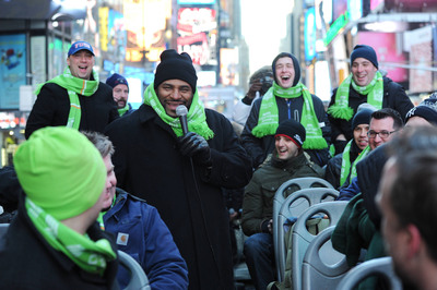 """Courtyard by Marriott surprised a bus full of football enthusiasts with an unforgettable treat - Jerome """"The Bus"""" Bettis driver and Rich Eisen tour guide. (PRNewsFoto/Courtyard by Marriott) (PRNewsFoto/COURTYARD BY MARRIOTT)"""