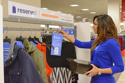 A Sears associate stocks the Reserve It rack with customer merchandise requests made through Shop Your Way. Items are reserved for 48 hours.