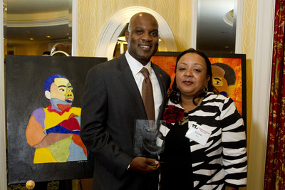 Lamell McMorris accepts his award for his individual commitment to serving the Children of the District of Columbia.  (PRNewsFoto/Perennial Strategy Group, Kristian Whipple)