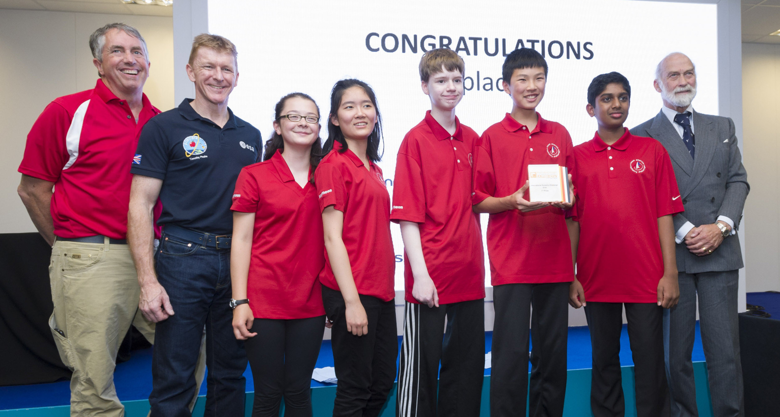 """Congratulations, 2016 International Rocketry Challenge winners, Odle Middle School of Bellevue, Wash! The """"Space Potatoes"""" bested teams from France, Japan and the United Kingdom to take the title of world champions. This is the second consecutive year that a U.S. team has won the championship. (L to R: NAR representative John Hochheimer, UK astronaut Tim Peake, Odle team captain Mikaela Ikeda, Stephanie Han, Karl Deerkop, Larry Jing, Srivatshan Sakthinarayanan, and His Royal Highness Prince Michael of Kent. Photo courtesy of the Raytheon Company.)"""