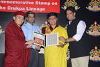 His Holiness the Gyalwang Drukpa, Eminence Drukpa Thuksey Rinpoche and Arjun Pandey receiving the Commemorative stamp from Sri SK Sinha of Department of Post, Government of India