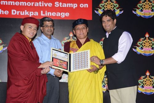 His Holiness the Gyalwang Drukpa, Eminence Drukpa Thuksey Rinpoche and Arjun Pandey receiving the Commemorative stamp from Sri SK Sinha of Department of Post, Government of India (PRNewsFoto/Preface Consultancy Services)