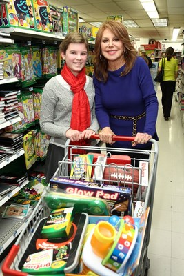 St. Jude patient, Mary, age 11 and St. Jude National Outreach Director Marlo Thomas stock shopping carts full of Kmart Fab 15 toys while on a shopping spree to benefit St. Jude Children's Research Hospital patients as part of Kmart's 11th annual St. Jude Thanks and Giving campaign last December in New York City.