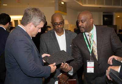 Scott Thiele, Chief Purchasing Officer, FCA NV (left), Kevin Bell, Head of Diversity Supplier Development and Training, FCA US (center), and Steven Phillips, ConForm Automotive President and CEO (right) discuss material options during the 17th annual MatchMaker held at FCA US headquarters in Auburn Hills, Mich., on Sept. 15, 2016. MatchMaker provides more than 250 minority-, women- and veteran-owned businesses access to 3,000 attendees ranging from FCA US leadership and buyers to tier one suppliers and leaders to advocacy and certifying organizations.
