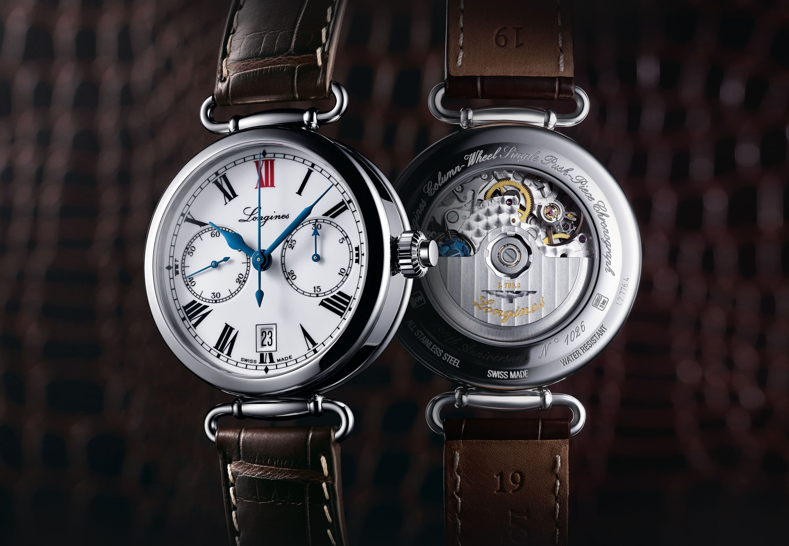 """The Longines Column-Wheel Single Push-Piece Chronograph models take their inspiration from the first chronograph wristwatches developed by Longines in 1913. This steel model is fitted with the L788 calibre, a column-wheel single push-piece chronograph movement developed by ETA exclusively for Longines. With its 40 mm diameter, its case is fitted with moving lugs. The white dial features black Roman numerals and a red """"XII"""", a small seconds at 9 o'clock and a 30-minute counter at 3 o'clock. The date aperture is situated at 6 o'clock. Blued hands harmoniously complete this timepiece, which comes with a brown alligator strap. (PRNewsFoto/Longines)"""