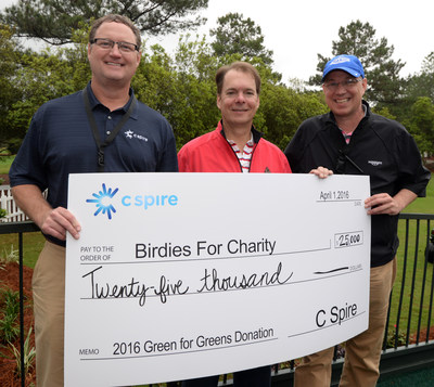"""C Spire COO Kevin Hankins, Gulfport Mayor Billy Hewes and Mississippi Gulf Resort Classic tournament director Steve Nieman (left to right) are all smiles after the Mississippi-based  telecom and technology company donated $25,000 to the Birdies for Charity organization, which benefits Mississippi-based non-profit groups. C Spire, presenting sponsor of the Mississippi Gulf Resort Classic, raised the funds as part of its """"Green for Greens"""" challenge during the annual Pro-Am at Fallen Oak in Saucier, Miss.."""