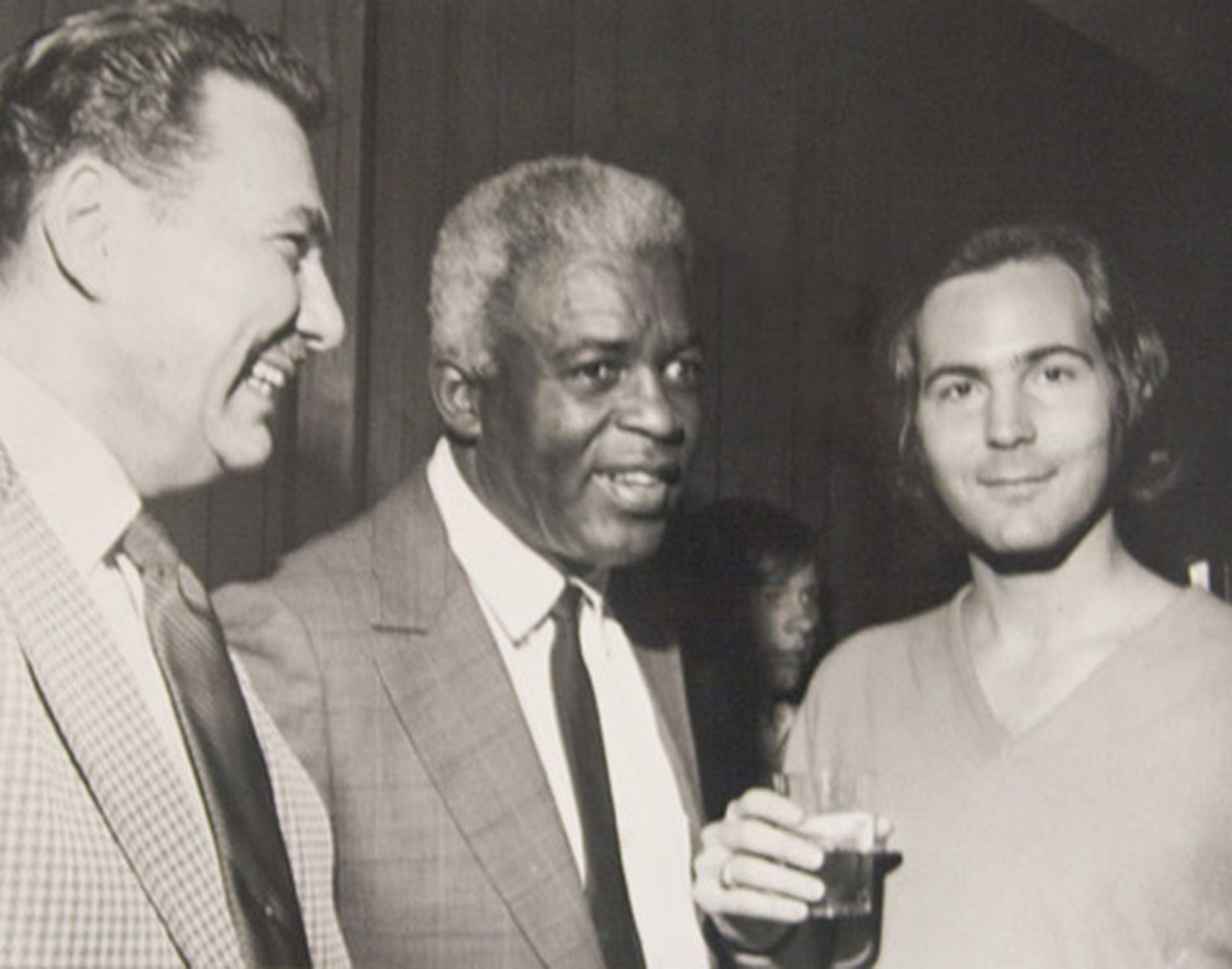 Young Bruce Merrin with legendary Jackie Robinson, Brooklyn Dodgers superstar and member of the Baseball Hall of Fame.  Jackie wore number 42 on his uniform, and Bruce Merrin's Celebrity Speakers is celebrating its 42 year anniversary.  Jackie was the first sports star that Brucebooked.
