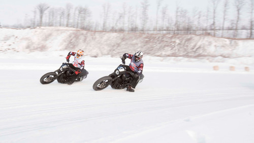 Reigning AMA Pro Grand National champion Brad Baker and 2012 AMA Pro Grand National champion Jared Mees take an icy corner on the all-new Harley-Davidson Street(TM) 750 during a motorcycle ice racing exhibition. The exhibition, part of a Harley-Davidson sponsorship, will be featured tonight during ESPN's X Games Aspen broadcast. Fans will help decide if the sport is extreme enough for future X Games winter events by using the hashtag #XGIceRace on Twitter. (PRNewsFoto/Harley-Davidson Motor Company) (PRNewsFoto/HARLEY-DAVIDSON MOTOR COMPANY)