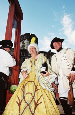 """Eastern State Penitentiary's Bastille Day celebration on Saturday, July 14 in Philadelphia features dozens of French revolutionaries, who will storm the grim walls of """"the Bastille"""" (Eastern State Penitentiary), capture Marie Antoinette, and ignoring her mocking cries of """"Let them eat Tastykake!"""" will drag her to a real, functioning guillotine as 2,000 Tastykakes are flung from the prison's towers."""