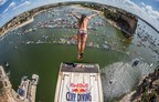 Orlando Duque takes flight at Red Bull Cliff Diving 2014 in Possum Kingdom Lake. Credit: Red Bull Content Pool/Romina Amato