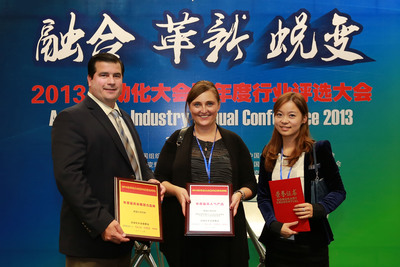 Red Lion Controls executives at an awards ceremony at the 2013 Industrial Automation Show in Shanghai (L-R): Daniel Faia, Vice President of Global Sales; Tracy Courtemanche, Global Marketing Director and Celine Zhang, APAC Marketing Manager.  (PRNewsFoto/Red Lion Controls)