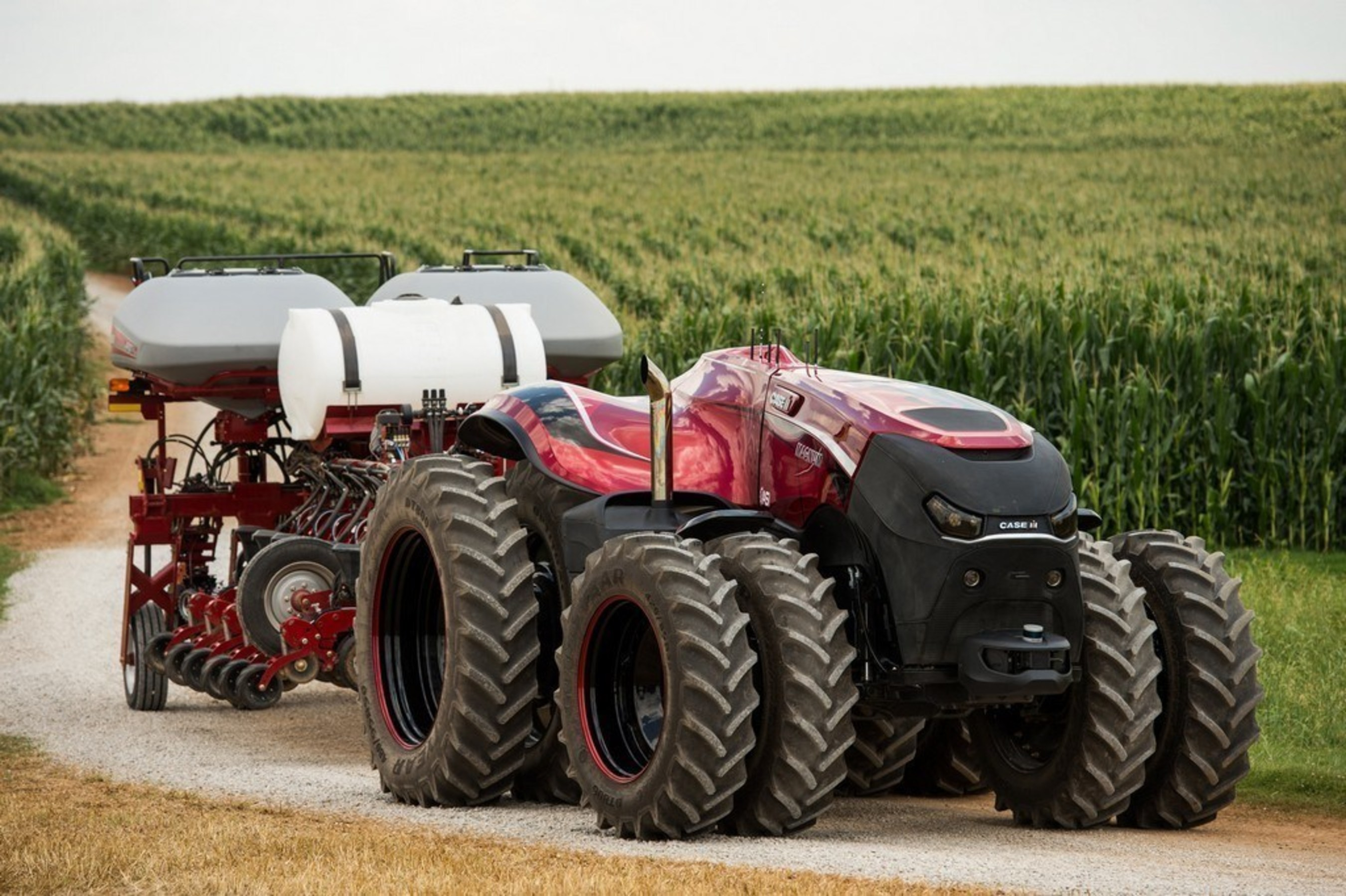 Case IH Magnum Autonomous Concept Tractor on the road with the Case IH Early Riser 2150 Planter in transport position