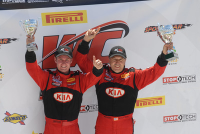 Kia Racing Infinity Audio Optima drivers Michael Galati and Mark Wilkins celebrate their one, two finish in round eight of the Pirelli World Challenge at Canadian Tire Motorsports Park.  (PRNewsFoto/Kia Motors America)