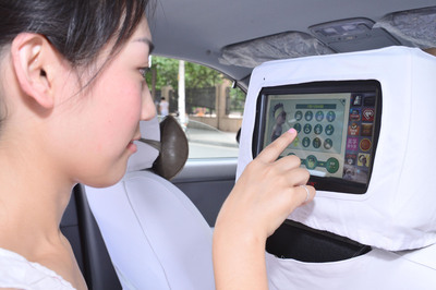 Passengers can register for Mr. and Miss WOW 45 days challenge through Touchmedia in-taxi interactive screens in Beijing and Shanghai.  (PRNewsFoto/Touchmedia)