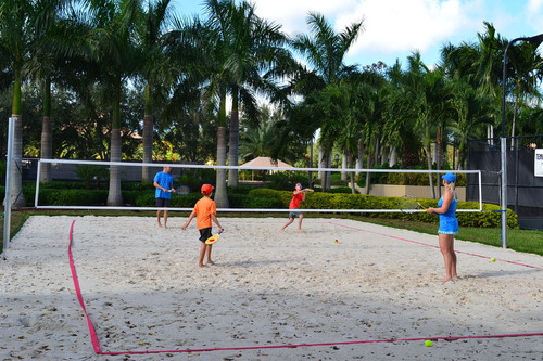 Boca Grove family enjoys playing in the first private beach tennis court in the area. (PRNewsFoto/Boca Grove Golf and Tennis Club)