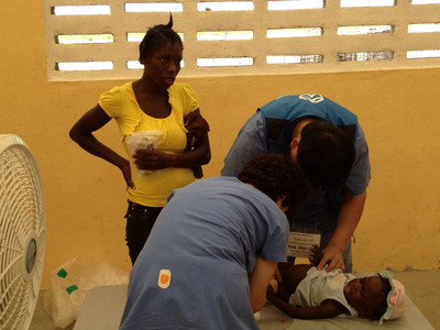 Medical team sponsored by Sae-A Trading treats an infant in Haiti.  (PRNewsFoto/Sae-A Trading Co., Ltd.)